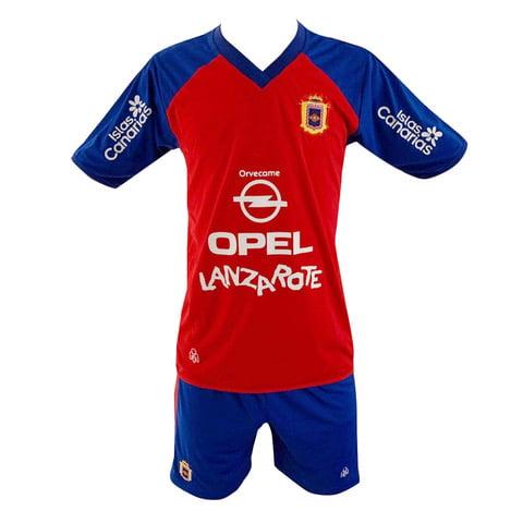Lanzarote Football red shirt blue shorts